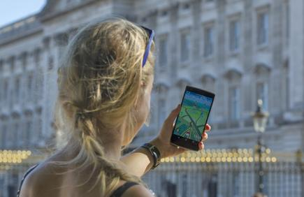 Woman with phone showing Pokemon Go