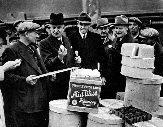 Food minister Lord Woolton holds one of four million eggs sent to Britain from the US in 1941.