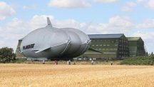 The Airlander 10 - part plane, part airship - delicately emerged from a giant hangar at Cardington Airfield in Bedfordshire