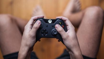 Gamer using Xbox One controller