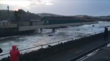 You need to see these people surfing down a river in Cornwall as Storm Imogen takes hold