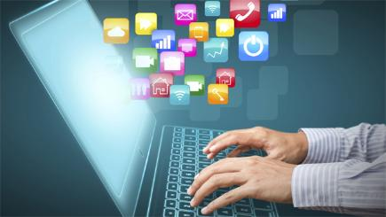 Laptop with hands graphics of apps