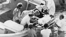 A body is lifted aboard the rescue boat after Earl Mountbatten's boat is destroyed by a bomb.