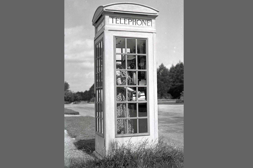 A telephone Kiosk No 3 in use at Moor Park. 1935.