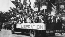 Parisians celebrate liberation while riding on a truck