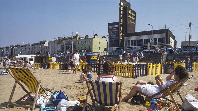 Beachgoers basking in the sun at the entrance of Dreamland.