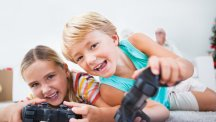 Pair of children playing games T
