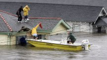 Bryan Vernon and Dorothy Bell are rescued from their rooftop after Hurricane Katrina hit.