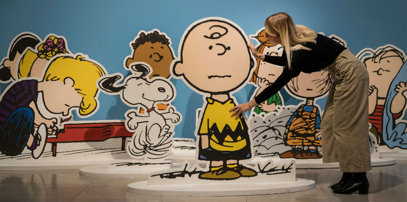 Large cut-out Peanuts characters are installed ahead of the Good Grief, Charlie Brown! exhibition at Somerset House, London, in October 2018.