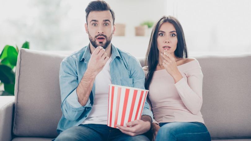 Couple amazed by TV