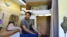 Couple pack it all in move into their new mobile home – an old white van