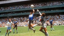 Diego Maradona scores against England in the World Cup quarter-final - with his hand.