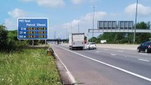 Artist's impression of electronic motorway signs displaying the price of fuel at upcoming service stations (Highways England/PA)
