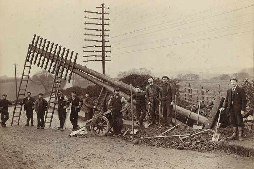 Engineering gang erecting a telegraph pole. c1895.