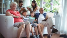 Parents, children and grandparents using laptops, phones and tablets
