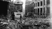 Firemen assess the damage in the streets around the Monument in the City of London.