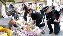 Flowers are left in St Ann's Square, Manchester after the suicide bombing