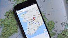 Map with phone showing Google Maps