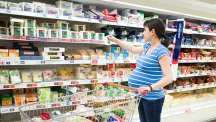 Pregnant woman shopping in supermarket