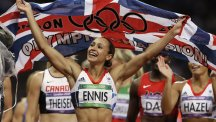 Jessica Ennis celebrates her heptathlon victory at the Olympic Stadium.