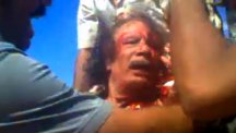 Libyan leader Muammar Gaddafi is captured and beaten.