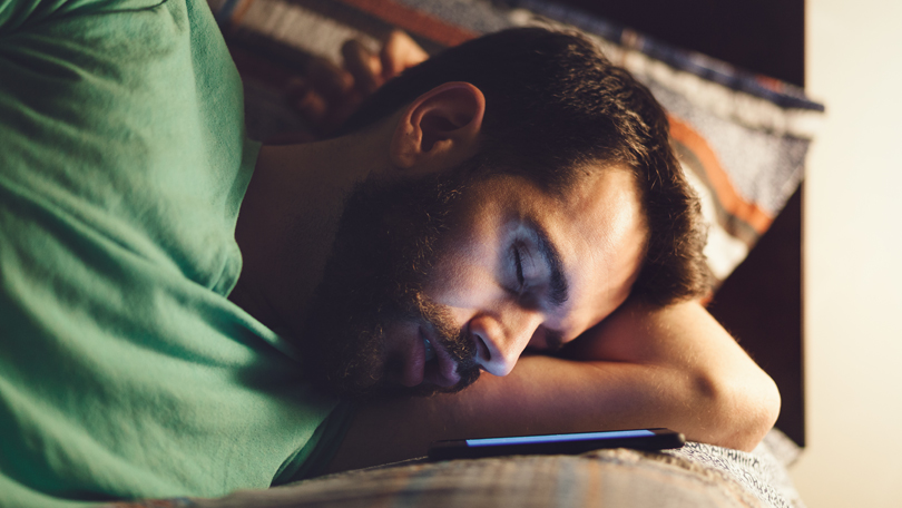 Man sleeping with phone