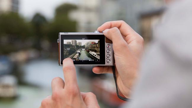Image result for man take picture with pocket camera