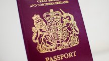 May urged to explain passport decision to British workers