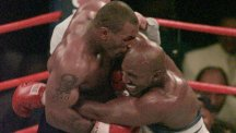 Mike Tyson bites into the ear of Evander Holyfield in their world title fight of 1997.