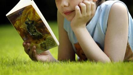 There has been a huge growth in the number of children who are picking up books outside school, The Literary Trust said