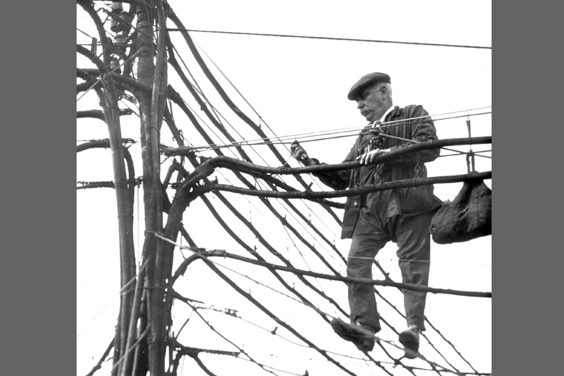 National Telephone Company lineman working on overhead cables. c1900.