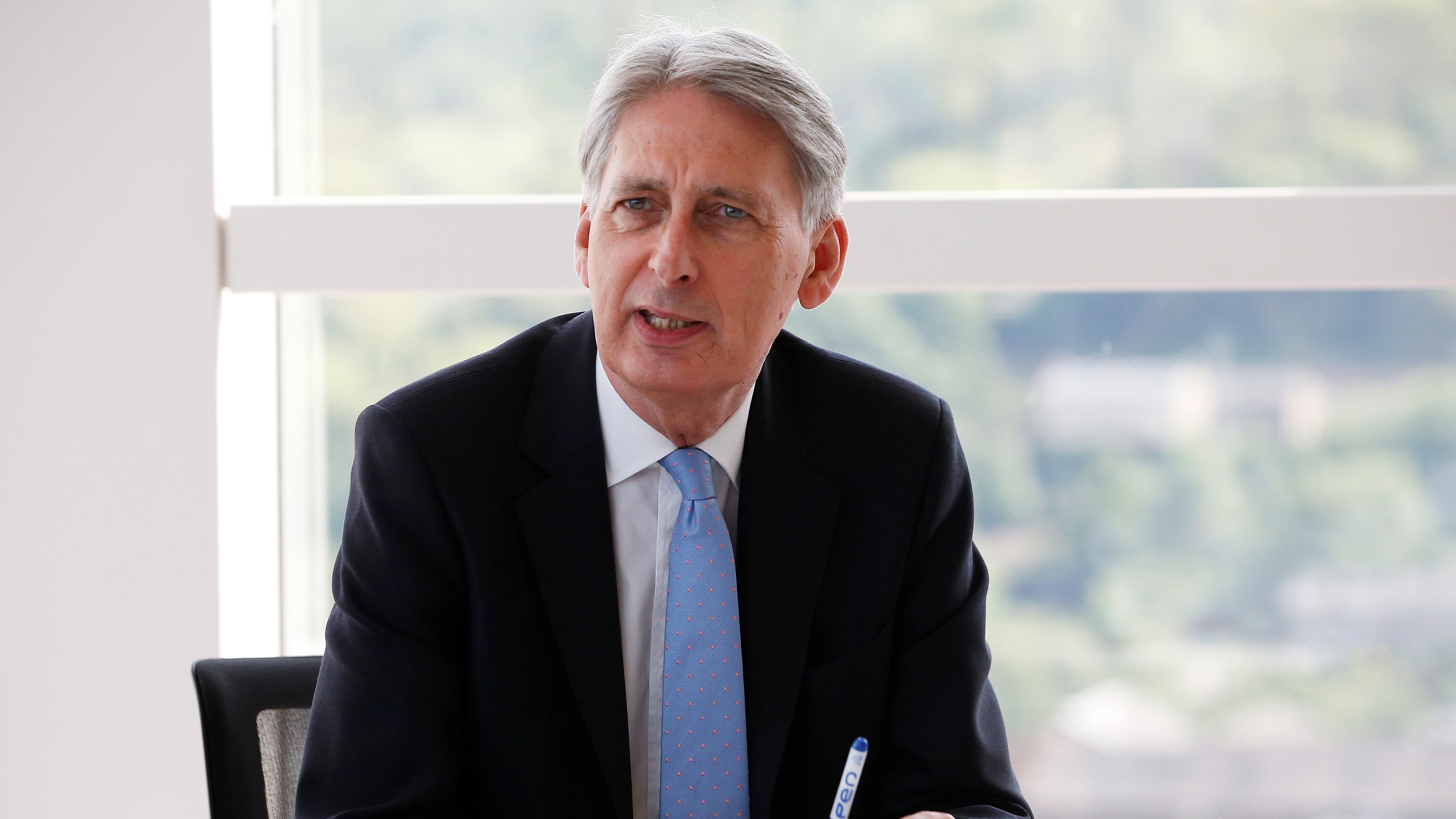 af3c23b19ec5 Philip Hammond boosted as borrowing revised downwards