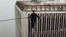 Philippe Petit is perched on a high wire strung between the Twin Towers of New York's World Trade Center