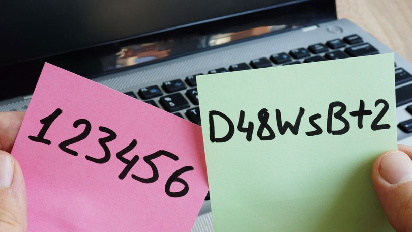 Laptop with sticky notes and poor passwords