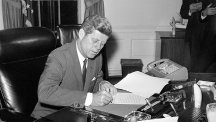 President Kennedy issues proclamation 3504 interdicting the delivery of offensive weapons to Cuba on October 22, 1962.