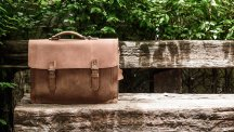 Brown satchel on bench