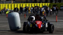 Two competitors try out a hot lap in an Ariel Atom car in the media preview of the Race of Champions.