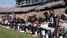 Scores of American football players defiant after Trump national anthem comments