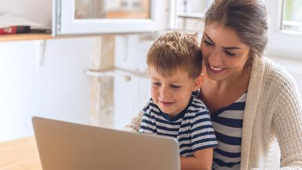 Woman and boy looking at laptop