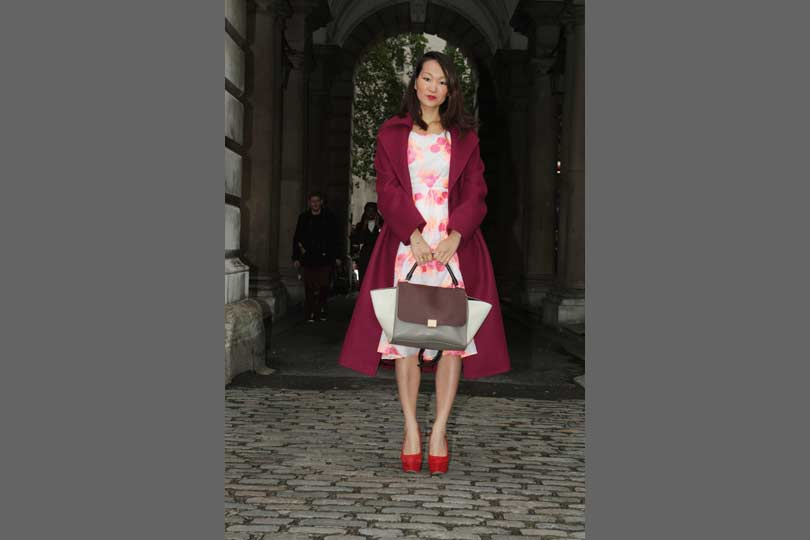 Spring florals are given an autumnal makeover with a maroon coat and tricolour bag.