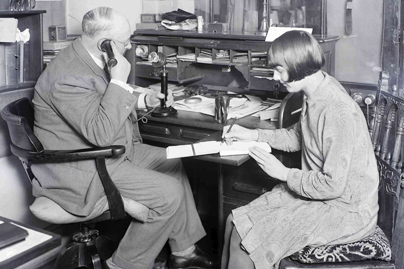 Subscriber using telephone extension at Liberty's Department Store. 1930.