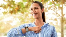 Fitbit Versa on womans arm smiling