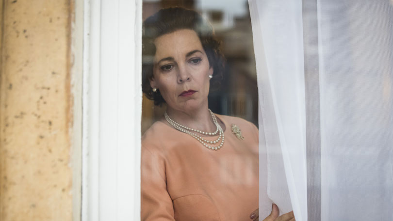 The Crown season 3 - Olivia Colman peeks around curtains