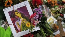 Tributes to singer Amy Winehouse outside her North London home.