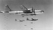 US Boeing B-29 Superfortresses dropping bombs in August 1950.