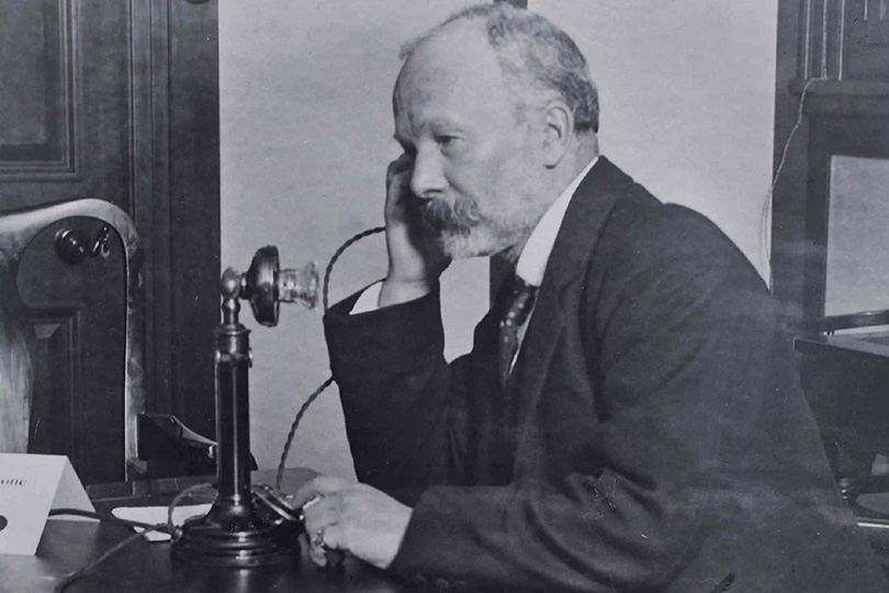 Using a candlestick telephone. 1921.