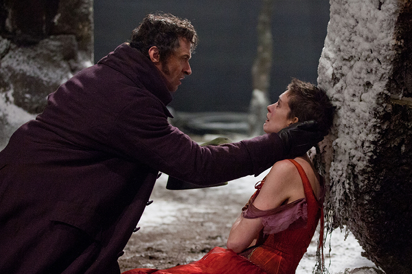 Valjean helping Fantine who is out in the cold