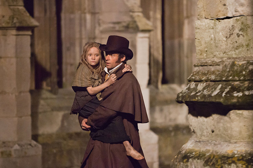 Valjean walking carrying little girl Cosette