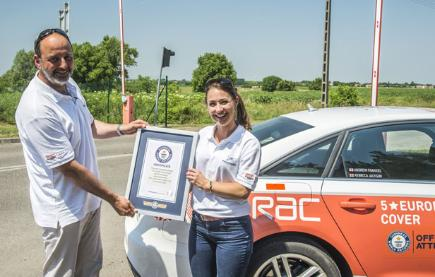 Andrew Frankel and Rebecca Jackson, who broke the record for the most countries driven through on one tank of petrol, with their certificate.