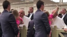 Watch this sassy girl steal the Pope's hat